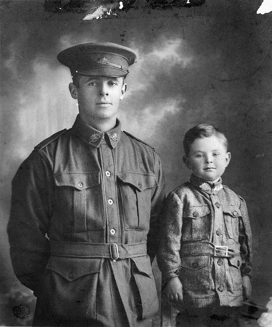 Father and son, 1916. Private Walter Henry Chibnall, 10th Light Trench Mortar Battery, pictured with his son William Beresford (Billy) Chibnall. He was killed in action at Passchendaele, Belgium, on 12 October 1917, aged 32, when he and a comrade were hit by a shell while taking shelter in a crater.  Billy Chibnall enlisted during WWII, serving with the 2/21st Battalion.  He was taken prisoner of war and died, aged 30, in 1942 at Ambon.