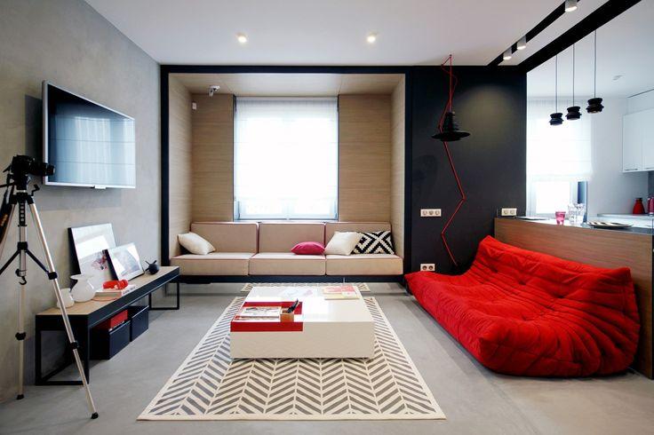 Nika Vorotyntseva nous partage une de ses réalisations, l'aménagement d'un appartement individuel au 20ème étage d'un immeuble à Kiev... L'habitation est moderne et assez minimaliste, elle comprend une cuisine ouverte sur un salon lumineux et une chambre avec sa salle de bains. La palette de couleurs utilisée est simple mais efficace, elle associe, noir, blanc, gris et des touches de rouge, fil conducteur dans chaque pièce. Côté matériaux, on trouve du bois, des briques