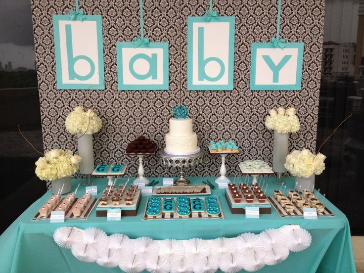 table in front of fireplace with desserts and backdrop but different than this baby baby shower bluebaby shower candy