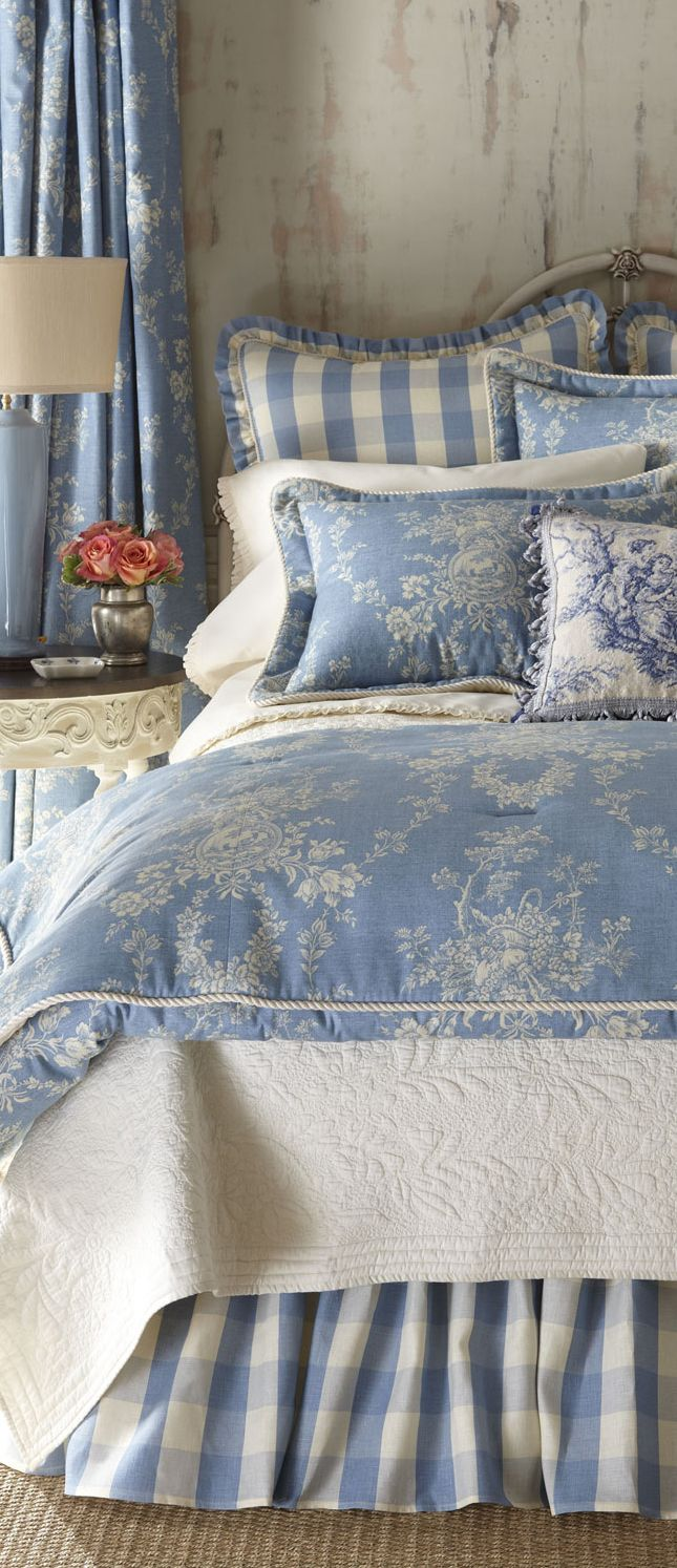 Love this bedding. Beautiful blue and I love the mixture of patterns