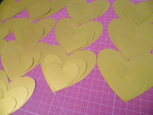 Gold hanging hearts in progress…  Luxury handmade paper decorations by Paper Street Dolls  Check out our store - paperstreetdolls.etsy.com