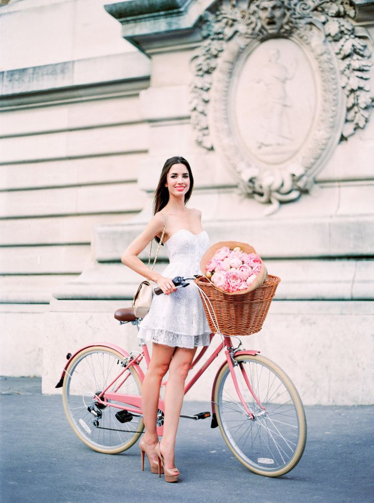 Pink bicycle with a Basket of flowers