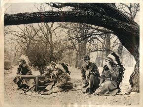 """1941- Meskwaki Indian """"code talkers"""" from the Sac and Fox reservations near Tama, Iowa, training to operate walkie-talkie radio units and field telephones which they will use to relay messages."""