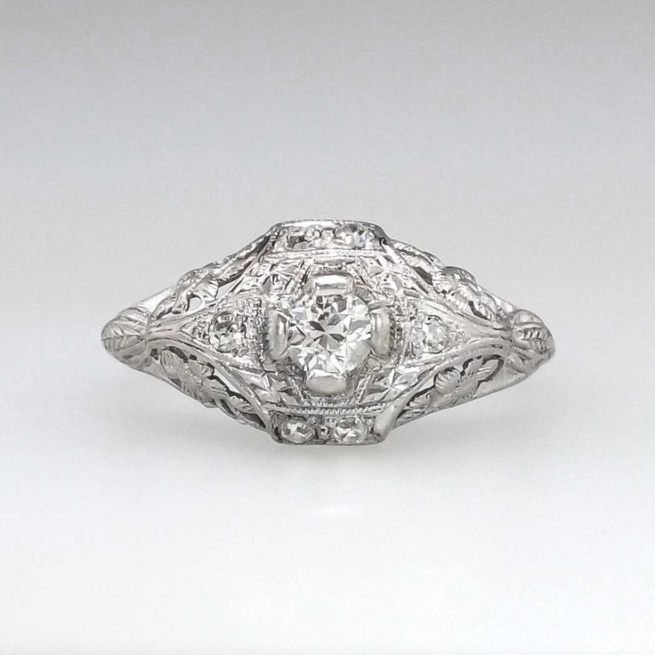 Beautiful Edwardian .27ct t.w. Old European Cut Floral Filigree Engagement Ring Platinum | Antique & Estate Jewelry | Jewelry Finds Price $1399.00  Such an extraordinary delicate and intricate engagement ring from our past! Made entirely in platinum, this engagement ring hails from the 1920's and has beautiful floral filigree work with subtle engraving and glittering antique cut diamonds!