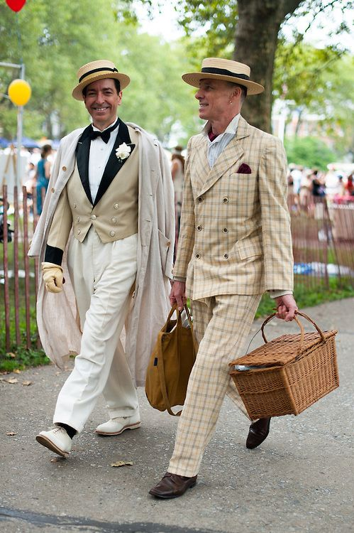 Mid 1920s 'Jazz Suits' were trendy because after WWI, people started to live a different lifestyle that led away from the formal three piece suit with shoulder pads. Life became edgier, more party-like and men dressed in simpler clothing, with hats, and fashionable chastises to go out dancing and partying.
