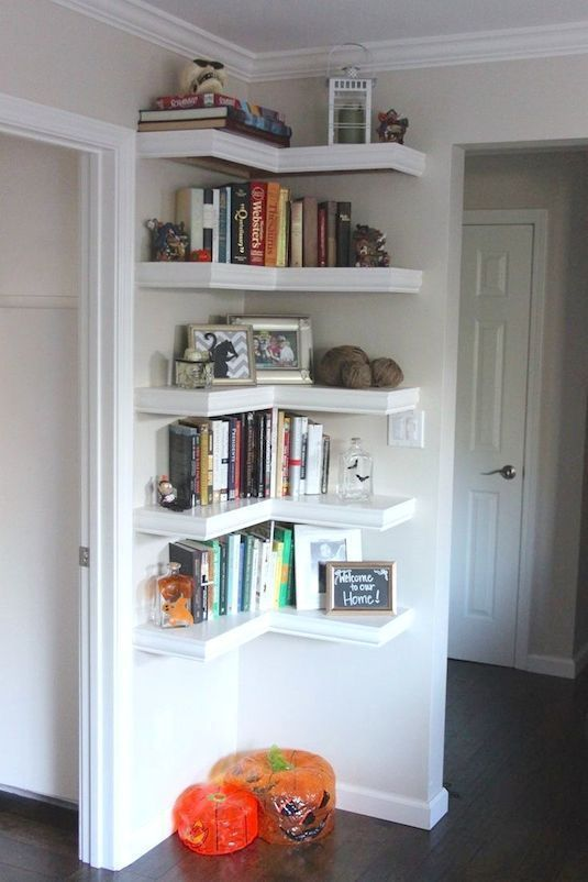 Put shelving in unused corners of the house to make the most of every last inch of space in your home. A great storage solution.: