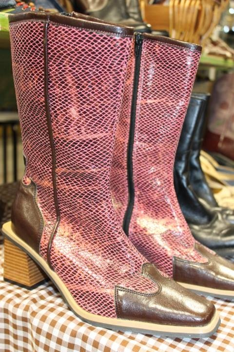 Ladies pink faux snakeskin boots.