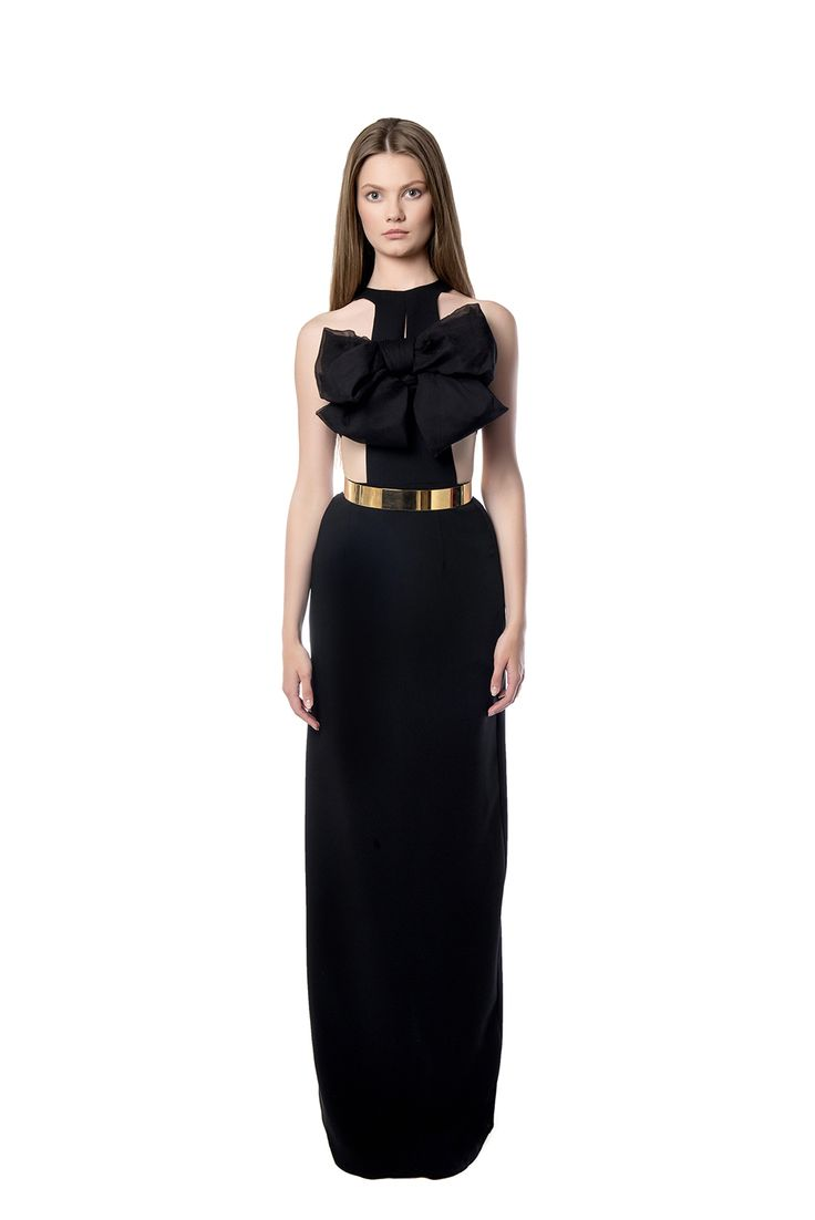 Maxi black dress detailed with a bow  Catch everybody's eye with this maxi dress cut by black crepe, with a beautiful detail on the frontal upper area and easy – going simple lower area. Perfectly paired with a gold belt provided for the waist.