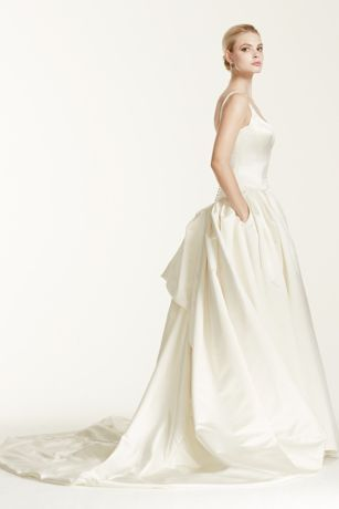 Remember when you were little and used to envision, or even sketch, your dream wedding dress? Well, someone made that a reality, and that someone is none other than Zac Posen. This duchesse satin ball gown is a lifelong fantasy come true with a cathedral train, bustle-back skirt, tank straps, and cartridge pleating at the drop waist.  Truly Zac Posen, exclusively at David's Bridal.  Also available inExtra Length. Check your local stores for availability.  Cathedral train. Fully