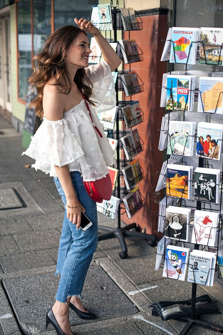 Northside books store in Northbridge Perth, Jenelle from fashion blog Inspiring Wit wearing Hello Parry off shoulder top, The Daily Edited monogrammed bag for City of Perth