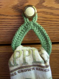 A dish towel ring/holder designed for drawer knobs rather than handles. Very quick and easy!