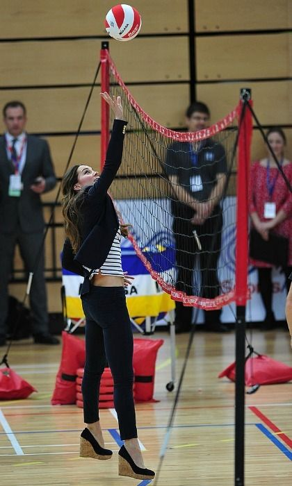 Spiking a volleyball  Spike it! If anything, Kate's wedges helped her reach even higher during a game of volleyball at the Queen Elizabeth Olympic Park in 2013.