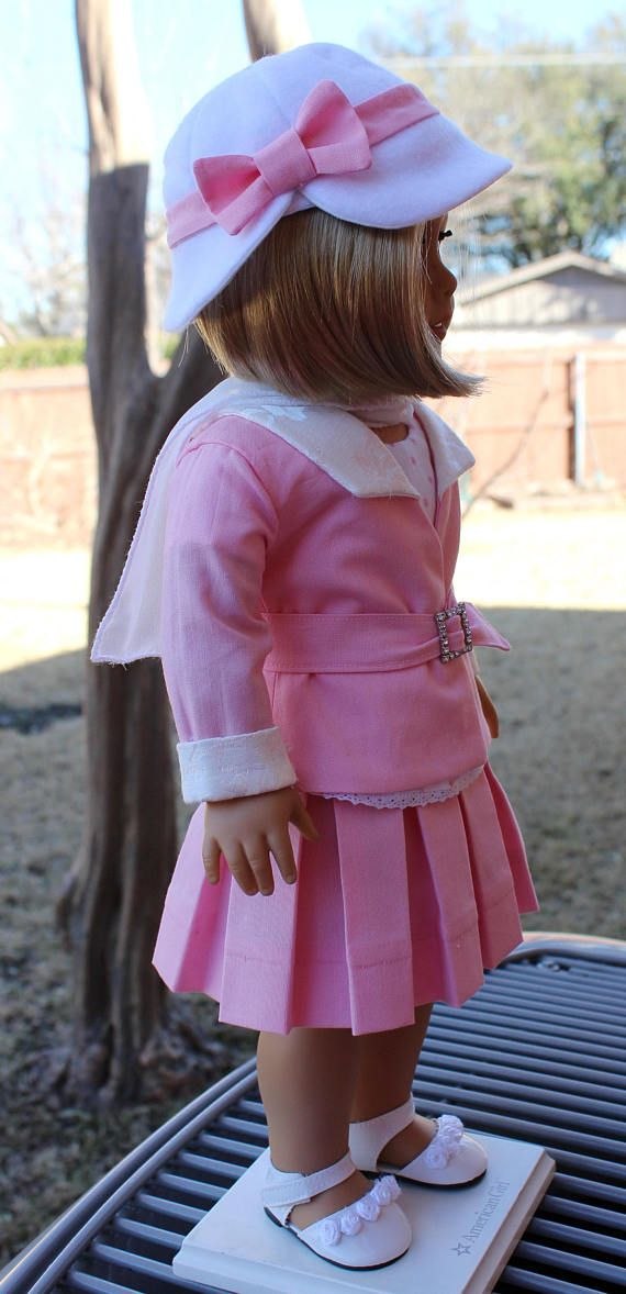 This outfit has been made to fit 18 dolls like American Girl. Please note that this outfit is fitted to the newer, slimmer American Girl dolls, so it might not fit the older, thicker ones. Ace reporter, Kit, loves this 1930s style pink suit. The outfit has a pleated skirt with a