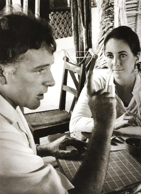 Elizabeth Taylor looking adoringly at Richard Burton, on the set of John Huston's 'The Night of the Iguana', 1964.