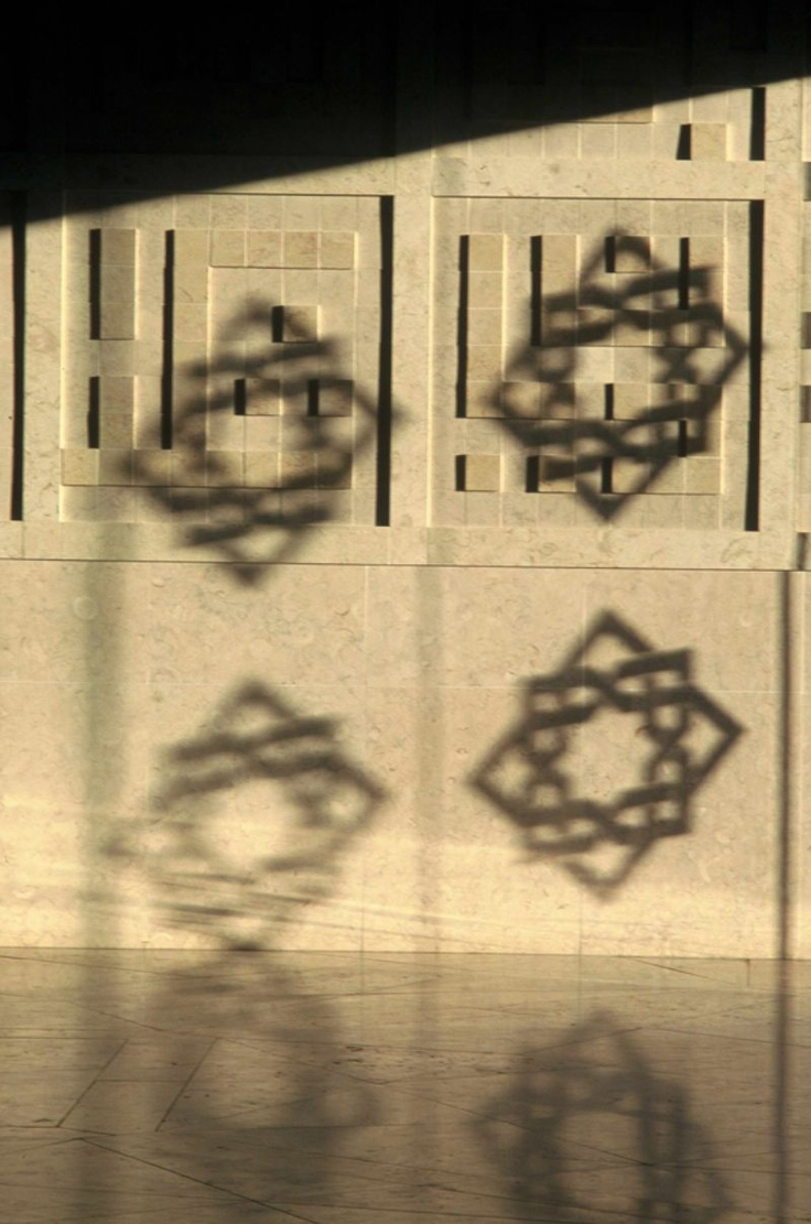 Ismaili Centre, Lisbon    Calligraphy, dappled by the motif. Photo: Gary Otte