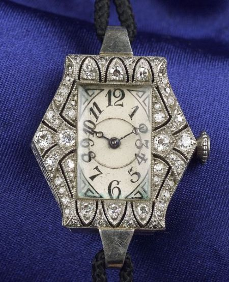Art Deco Platinum and Diamond Wristwatch, Whiteside & Blank, the white metal dial with Arabic numeral indicators, octagonal case with openwork bezel bead-set with single-cut diamonds, signed Cressarow Swiss 18-jewel adjusted movement no. 7530, completed by a grosgrain strap, hallmark,