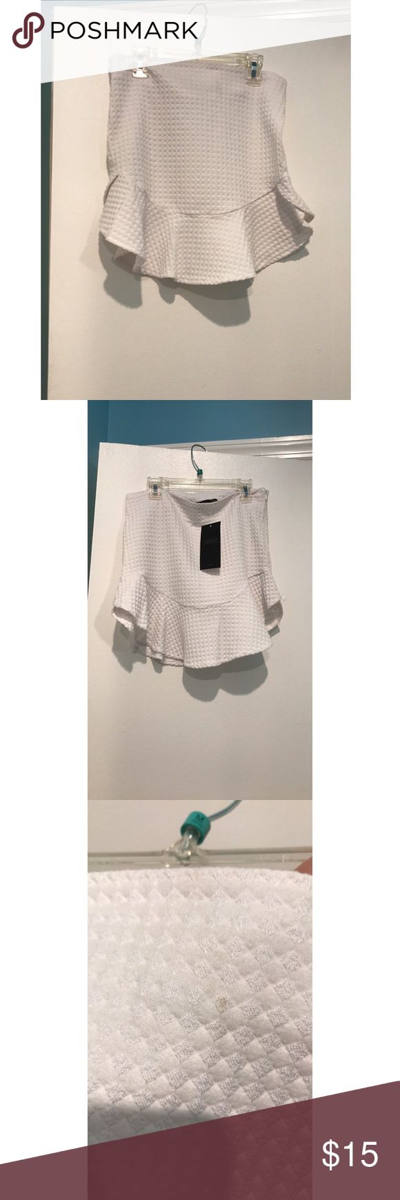 Trafaluc Zara white mini skirt Brand new White mini skirt. There is a small stain on the back as shown in the picture. There is a zipper on the side. Trafaluc Skirts Mini