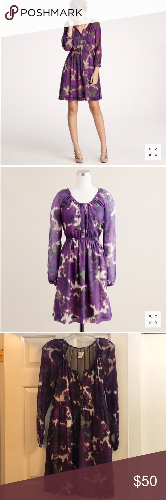 "Jcrew silk Maisie dress in floral size 0 Stunning JCrew silk dress with a purple and green watercolor floral print.  A-line shape is extremely flattering.  New condition except for pictured broken button on sleeve which does not effect wear (sleeve still stays buttoned) Measurements: Waist: 16"" Length from shoulder to hem: about 36"" Bust: 15"" J. Crew Dresses Midi"