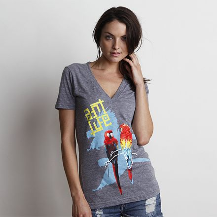 Birds of Paradise Vintage Grey V-Neck Tee on Art.Life is a super soft tri-blend fitted deep v-neck with large retro style front print, stitching detail on shoulder, and organic cotton neck label. MADE IN USA. #neckerisland #parrot #retro #triblend #lifestyle #artlife #southbay #cottontee #graphictee #womensstyle #womensfashion #cotton #ecofriendly #beachstyle #vintage #croptop #tropical #beachwear #womenswear #saveourseas