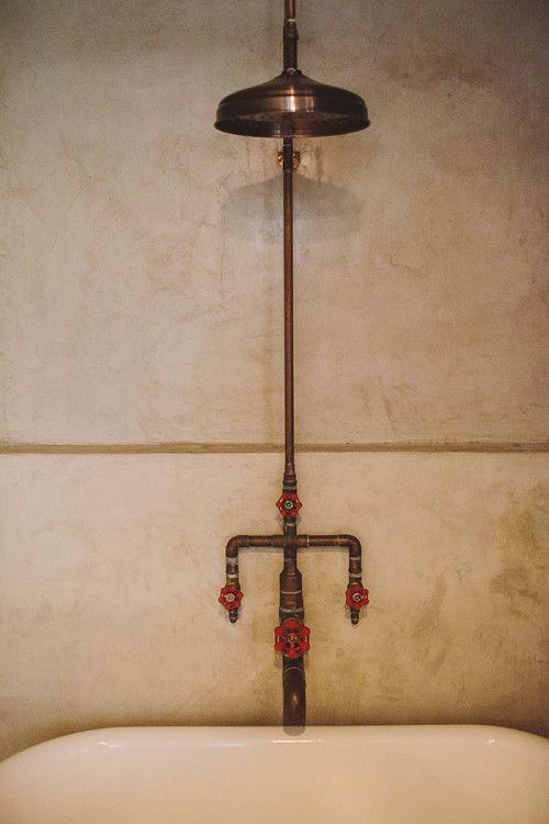 Exposed copper pipe shower with industrial handles. Home of Betsy Ginn of SMID via Design*Sponge.