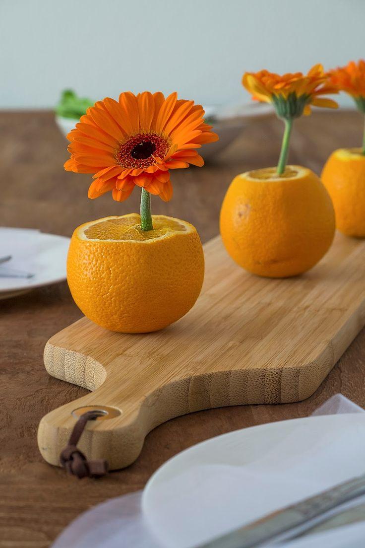 Tafeldecoratie met Gerbera's en sinaasappels - Diy tafel dekken