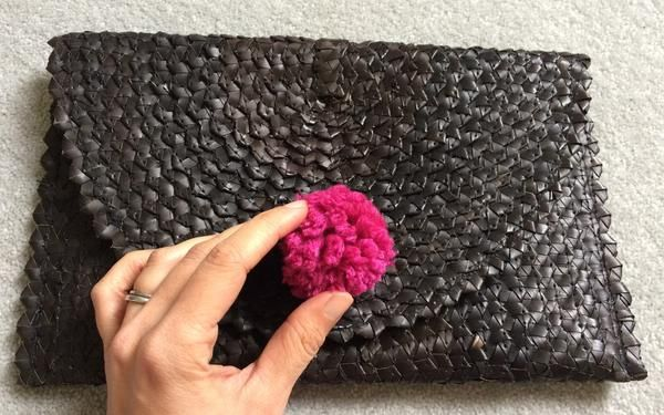 Add a pom-pom to your clutch bag. Read more on our blog at Desa Life. www.desa.life