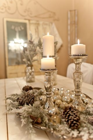 Christmas Centerpiece With Candles...pine cones and shiny vintage glass ornaments on a silver tray.