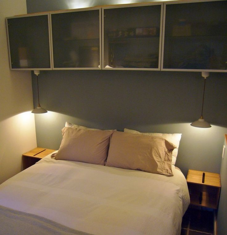 Contemporary Bedroom With Ikea Storage Bins Screwed Into The Wall Studs Act As Nightstands And