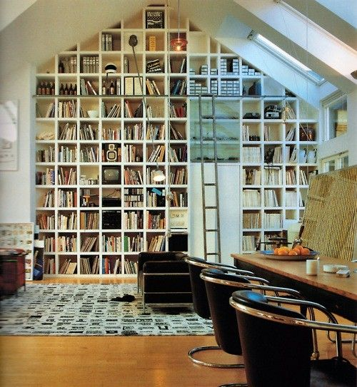 Floor to ceiling bookshelves, cathedral ceiling, squares