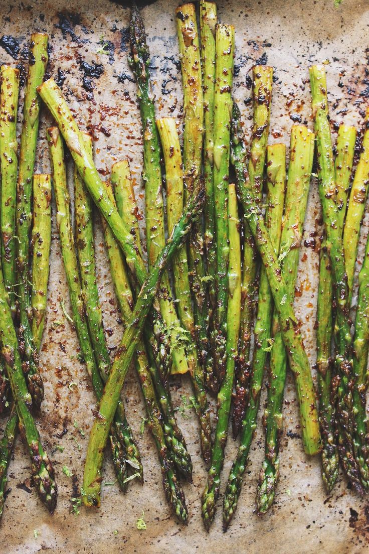 Simple, roasted chili lime asparagus is a perfect, vegan and naturally gluten-free spring side dish. Or enjoy chili lime asparagus on the grill.