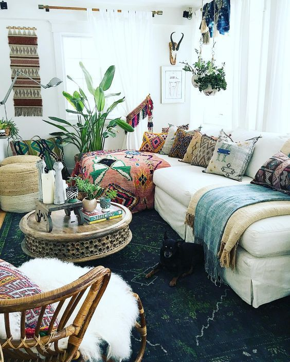 Layer a range of colours Mix bold textures to create a bohemian style home. Ikat print is paired with sheepskin