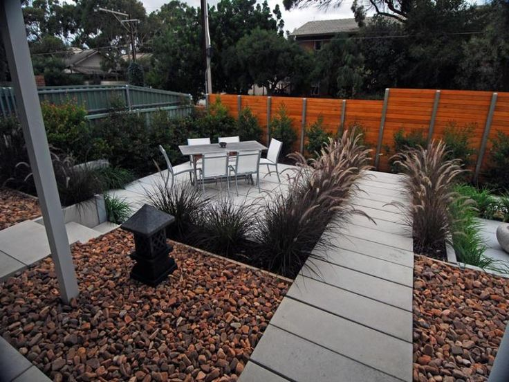 Photo Of A Low Maintenance Garden Design Using Pavers With Outdoor Dining U0026  Outdoor Furniture Setting   Gardens Photo Browse Hundreds Of Images Of Low  ...