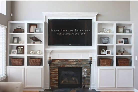 Media room idea!  ikea besta system cabinets to surround fireplace and tv. looks nice and is inexpensive. for the basement perhaps?.