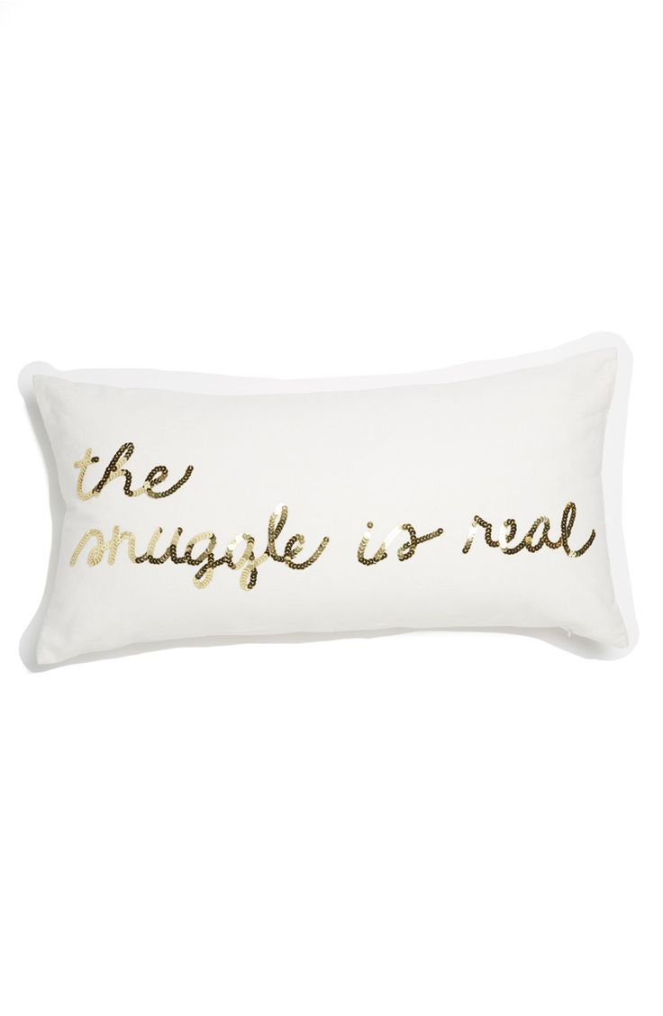 Love the glimmering sequins that spell out 'The Snuggle Is Real' on this utterly charming—and fabulously sparkly—accent pillow.