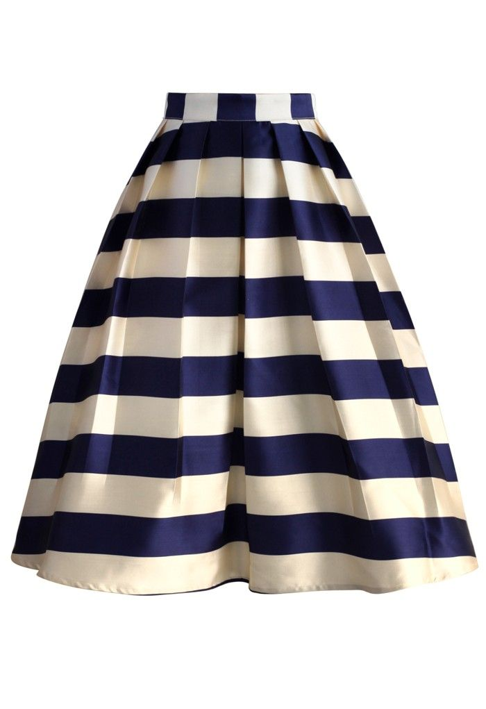 Sip tea and slay the masses in style wearing this flared midi skirt! With thick modern Scottish navy and ivory stripes presented with lovely pleats, this skirt is quite the subtle statement this fall. Slip into a simple knit top, heels and your biggest smile!  - Pleated silhouette - Back zip closure - Lined - 100% Polyester - Machine washable  Size(cm) Length Waist XS       68     66 S  ...
