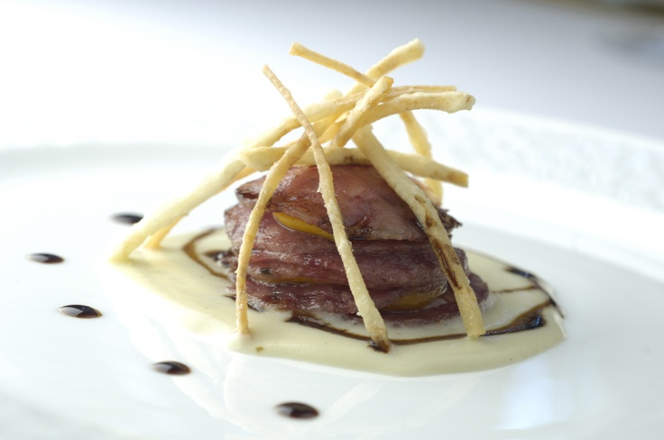 Millefoglie of cotechino (lean pig's trotter) on Bologna potato's cream and hand cutted fries. Ah! And San Giacomo's Traditional Balsamic Vinegar
