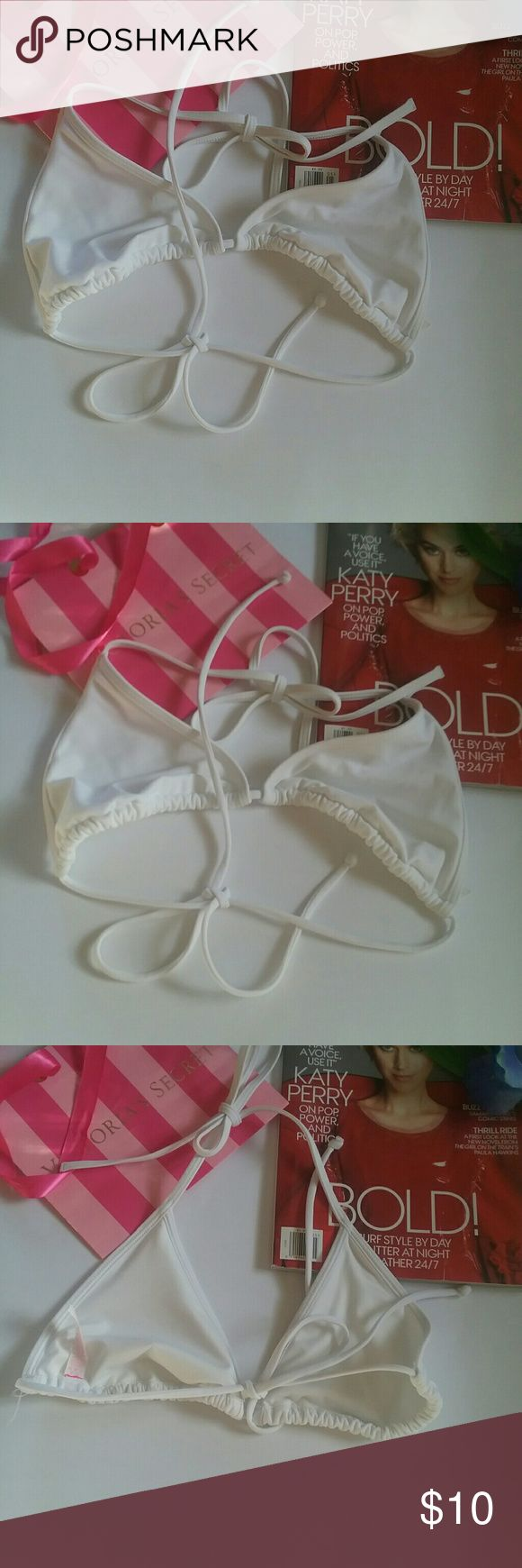 New Victorias Secret Triangle bikini Top Mef This is a new Victoria's Secret white triangle bikini top. It is size medium. IT IS NOT PADDED. It is a Victoria's Secret's Overstock so this size tag remains but the store Tags have been removed. Victorias Secret  Swim Bikinis