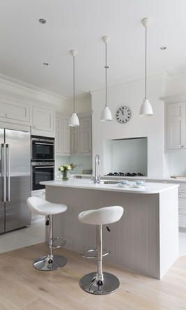 Love the colour here: Light partridge grey doors with glacier white corian tops.