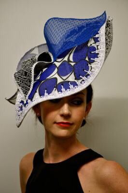 white, black, and royal blue hat