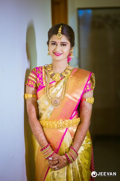 South Indian bride. Gold Indian bridal jewelry.Temple jewelry. Jhumkis.Gold and pink silk kanchipuram sari.Braid with fresh jasmine flowers. Tamil bride. Telugu bride. Kannada bride. Hindu bride. Malayalee bride.Kerala bride.South Indian wedding. Pinterest: @deepa8
