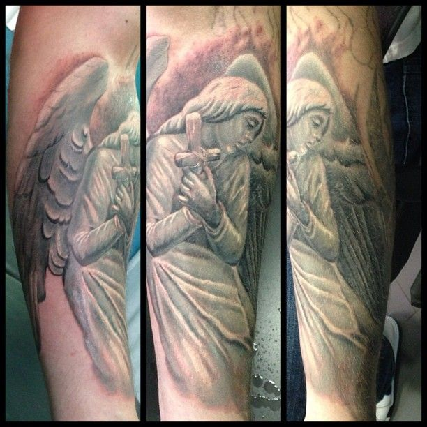 awesome grey ink angel tattoo on arm - http://tattooswall.com/awesome-grey-ink-angel-tattoo-on-arm.html #angel, angel tattoos, arm, awesome, grey, ink, on, tattoo