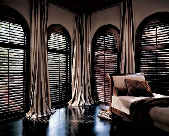 curtains along the wall and wooden shutters