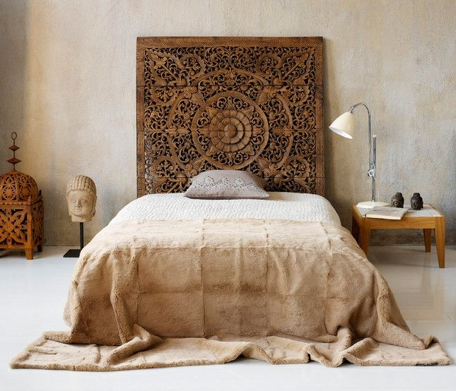 head board from salvaged architecture?  or wooden screen from a temple?  very beautiful.