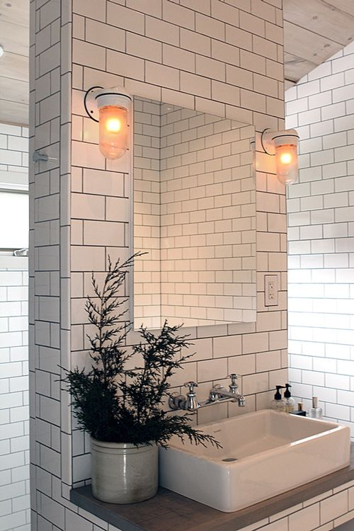 by Jeff Madalena and Jason Gnewikow, their own home in Williamsburg, Brooklyn; via designsponge.com - Duravit sink basin, wall mount taps by Chicago Faucets, medicine cabinet from Robern