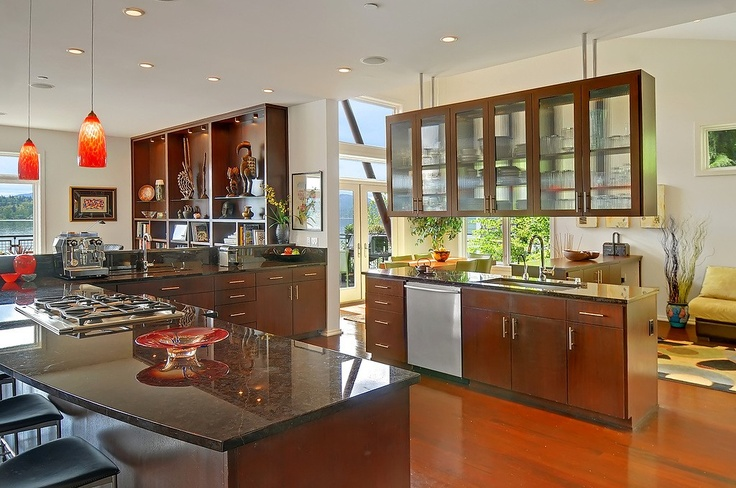 Wow - love this kitchen. Super open.  Suspended cabinets are odd, but it does form a barrier....