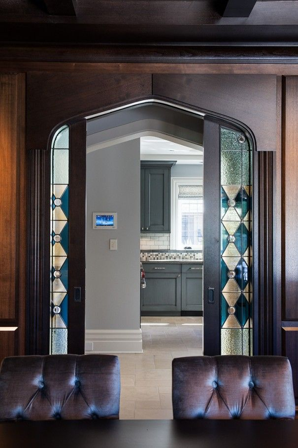 Tudor Revival Dining Room With Stained Glass Pocket Doors Leading To Butlers Pantry And Kitchen