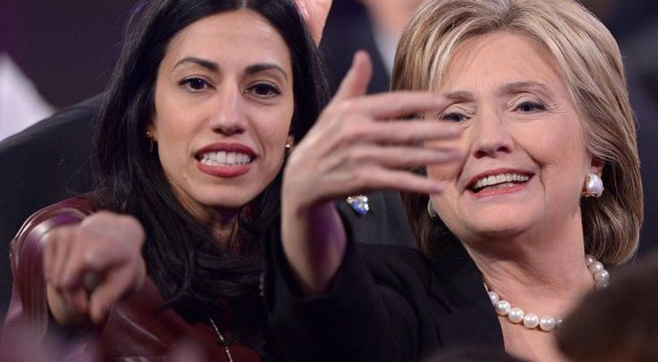 Democratic Presidential hopeful Hillary Clinton (R)  gestures next to Huma Abedin after the second Democratic presidential primary debate in the Sheslow Auditorium of Drake University on November 14, 2015 in Des Moines, Iowa. AFP PHOTO/ MANDEL NGAN        (Photo credit should read MANDEL NGAN/AFP/Getty Images)