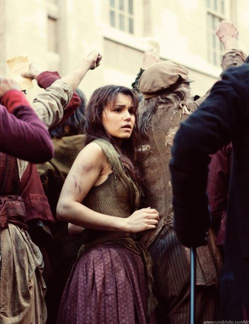 Les Mis (2012) | Samantha Barks (Eponine) caught in the cross fire in the big screen adaptation of Les Misérables.  I love Eponine so much.