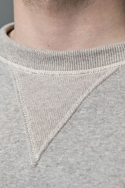 The often misunderstood triangle-shaped enforcement below the collar is no joke, but a reminder of the sweatshirt's roots in football. The ribbed V-notch enabled the collar to stretch, when football players wore their shoulder pads below their sweaters, thus the neckline kept it's shape. For more info: http://leangarments.com/products/loopwheeled-sweatshirt  #wardrobestables #essentials #sweatshirt #loopwheel #loopwheeled #madeinjapan #menswear #streetwear #rawdenim #workwear