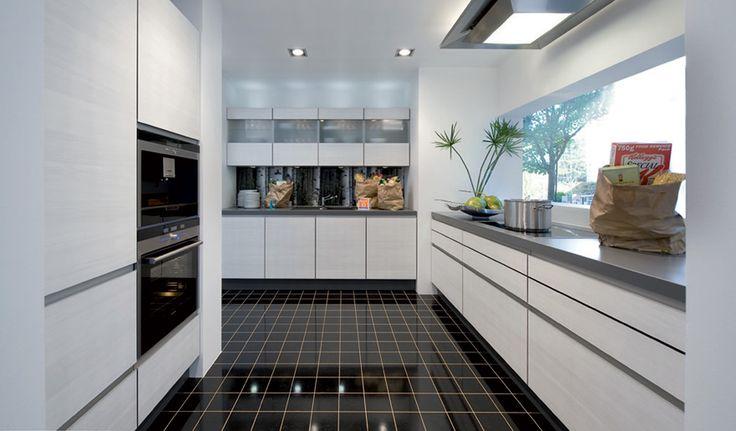 Lovely black floor tiling in this white 2 pack German style kitchen.  #floor tiles